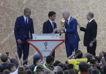 Former French soccer player David Trezeguet and (L), former Brazilian soccer player Bebeto (2nd-L), Russian President Vladimir Putin (R) and FIFA President Gianni Infantino (2R) attend the FIFA World Cup Trophy Tour kick-off ceremony at the Luzhniki Stadium in Moscow, Russia, 09 September 2017. The Original Trophy will travel through 24 Russian cities and visit more than 50 countries around the World.