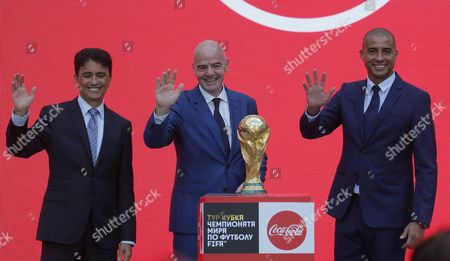 Former Brazilian soccer player Bebeto (L), FIFA President Gianni Infantino (C) and former French soccer player David Trezeguet (R) pose with the trophy at the FIFA World Cup Trophy Tour kick-off ceremony at the Luzhniki Stadium in Moscow, Russia, 09 September 2017. The Original Trophy will travel through 24 Russian cities and visit more than 50 countries around the World.