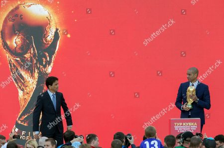 """David Trezeguet, Jose Roberto Gama de Oliveira. Former French soccer star David Trezeguet, right, and former Brazilian soccer star Jose Roberto Gama de Oliveira or """"Bebeto"""" present the FIFA World Cup trophy at Moscow's Luzhniki Stadium, Russia, on . From September 2017 onwards, the Trophy starts its tour over 24 Russian cities and more than 50 countries around the globe ahead of 2018 World Cup due to start at Luzhniki stadium on June 14, 2018"""