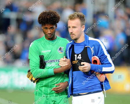 Alexis Andre-Jr of Bristol Rovers is congratulated by Chris Lines