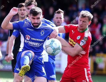Cliftonville vs Dungannon Swifts . Cliftonville's Stephen Garrett with Dungannon's Cormac Burke