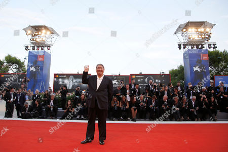 Takeshi Kitano poses for photographers during the red carpet for the closing ceremony at the 74th edition of the Venice Film Festival in Venice, Italy