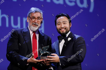 Eugene YK Chung, John Landis. Eugene YK Chung, right, is awarded the Venice Virtual Reality Prize for best VR from director John Landis during the award ceremony at the 74th Venice Film Festival at the Venice Lido, Italy