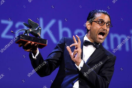 Stock Image of Director Alireza Khatami holds the Best Screenplay prize for 'Los Versos del Olvidois' during the award ceremony at the 74th Venice Film Festival at the Venice Lido, Italy
