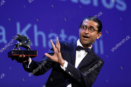 Director Alireza Khatami holds the Best Screenplay prize for 'Los Versos del Olvidois' during the award ceremony at the 74th Venice Film Festival at the Venice Lido, Italy