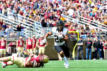 Stock Image of Chestnut Hill, Massachusetts, U.S. - Wake Forest Demon Deacons running back Matt Colburn (22) breaks a tackle by Boston College Eagles defensive tackle Ray Smith (96) during the NCAA division 1 football game between the Wake Forest Demon Deacons and the Boston College Eagles held at Alumni Stadium in Chestnut Hill, Massachusetts. Wake Forest defeats Boston College 34-10
