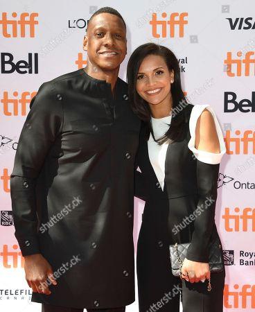 "Masai Ujiri, Ramatu Ujiri. Toronto Raptors President Masai Ujiri, left, and Ramatu Ujiri attend a premiere for ""The Carter Effect"" on day 3 of the Toronto International Film Festival at the Princess of Wales Theatre, in Toronto"
