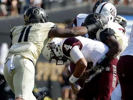 Aqeel Glass, Charles Wright, Emmanuel Smith. Alabama A&M quarterback Aqeel Glass (4) is sacked for a 6-yard loss by Vanderbilt linebackers Charles Wright (11) and Emmanuel Smith, right, in the first half of an NCAA college football game, in Nashville, Tenn