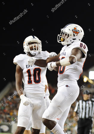 UTSA Roadrunners wide receiver Josh Stewart (80) and UTSA Roadrunners wide receiver Greg Campbell Jr. (10) celebrate a touchdown during the NCAA Football game between the Baylor Bears and the UTSA Roadrunners at McLane Stadium in Waco, Texas