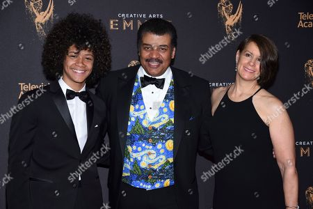 Travis Tyson, Neil deGrasse Tyson, Alice Young. Travis Tyson, from left, Neil deGrasse Tyson, and Alice Young arrive at night one of the Television Academy's 2017 Creative Arts Emmy Awards at the Microsoft Theater, in Los Angeles