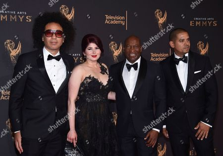 Stock Photo of John Signleton, One9. John Singleton, middle right, One9, right arrive at night one of the Television Academy's 2017 Creative Arts Emmy Awards at the Microsoft Theater, in Los Angeles