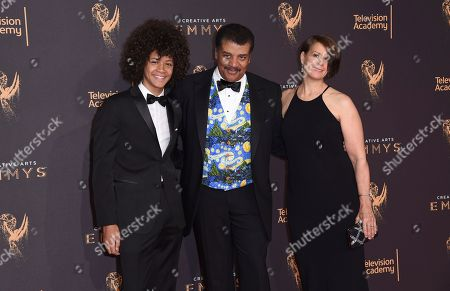 Travis Tyson, Neil deGrasse Tyson, Alice Young. Travis Tyson, from left, Neil deGrasse Tyson, and Alice Young arrive at night one of the Creative Arts Emmy Awards at the Microsoft Theater, in Los Angeles