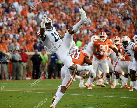Kyle Davis, Ryan Carter. Auburn wide receiver Kyle Davis (11) falls after failing to make a catch as Clemson cornerback Ryan Carter (31)defends during the first half of an NCAA college football game, in Clemson, S.C. Clemson won 14-6