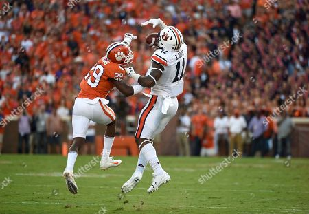 Kyle Davis, Marcus Edmond. Auburn wide receiver Kyle Davis (11) and Clemson cornerback Marcus Edmond (29) battle for the ball during the first half of an NCAA college football game, in Clemson, S.C. Clemson won 14-6