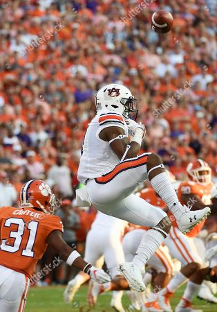 Kyle Davis, Ryan Carter. Auburn wide receiver Kyle Davis (11) grabs for a pass as Clemson cornerback Ryan Carter (31) defends during the first half of an NCAA college football game, in Clemson, S.C. The pass was incomplete