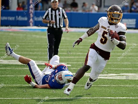 Central Michigan running back Jonathan Ward (5) gets past Kansas linebacker Keith Loneker Jr. (47) as he runs for a first down during the first half of an NCAA college football game, in Lawrence, Kan