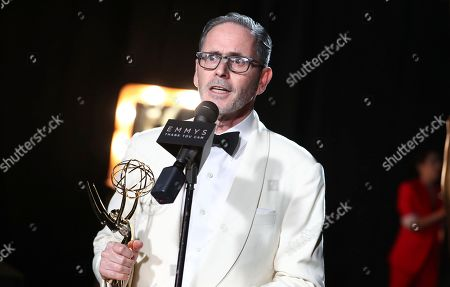 Keith Ian Raywood, winner of the award for outstanding production design for a variety, nonfiction, reality or reality-competition series for 'Saturday Night Live', attends night one of the Television Academy's 2017 Creative Arts Emmy Awards at the Microsoft Theater, in Los Angeles