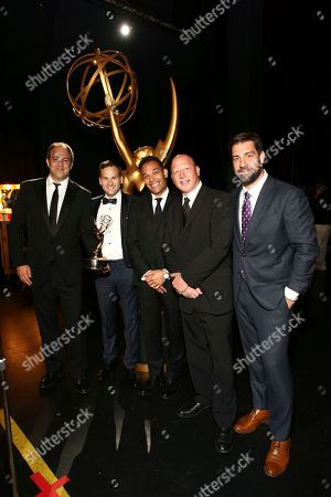 """Matt Renner, Dan Lindsay, TJ Martin, Jonathan Chinn, and Simon Chinn. The team from """"LA 92,"""" winners of the award for exceptional merit in documentary filmmaking, attend night one of the Television Academy's 2017 Creative Arts Emmy Awards at the Microsoft Theater, in Los Angeles"""