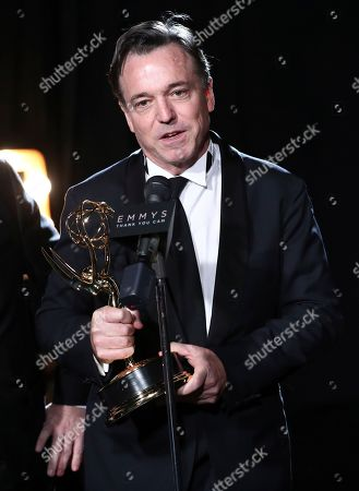 """Derek McLane from """"Hairspray Live!,"""" winner of the award for outstanding production design for a variety nonfiction, event or award special, attends night one of the Television Academy's 2017 Creative Arts Emmy Awards at the Microsoft Theater, in Los Angeles"""