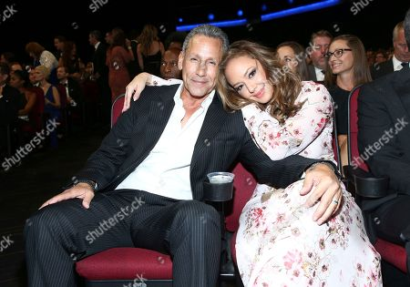 Stock Picture of Angelo Pagan, Leah Remini. Leah Remini, right, and Angelo Pagan attend night one of the Television Academy's 2017 Creative Arts Emmy Awards at the Microsoft Theater, in Los Angeles