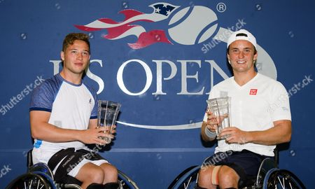 Gordon Reid and Alfie Hewett of Great Britain with their trophies after the wheelchair doubles final of the US Open
