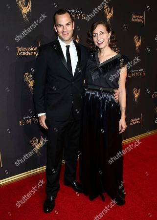 Stock Photo of Kristen Schaal, Rich Blomquist. Kristen Schaal, right, and Rich Blomquist arrive at night one of the Television Academy's 2017 Creative Arts Emmy Awards at the Microsoft Theater, in Los Angeles