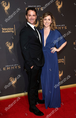Spencer Averick, left, and guest arrive at night one of the Television Academy's 2017 Creative Arts Emmy Awards at the Microsoft Theater, in Los Angeles
