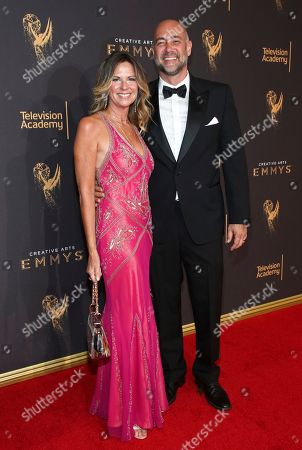 Mo Collins, Alex Skuby. Mo Collins, left, and Alex Skuby arrive at night one of the Television Academy's 2017 Creative Arts Emmy Awards at the Microsoft Theater, in Los Angeles