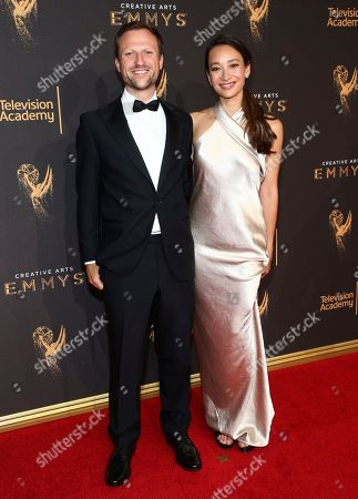 Stock Picture of Orlando von Einsiedel, Joanna Natasegara. Orlando von Einsiedel, left, and Joanna Natasegara arrive at night one of the Television Academy's 2017 Creative Arts Emmy Awards at the Microsoft Theater, in Los Angeles