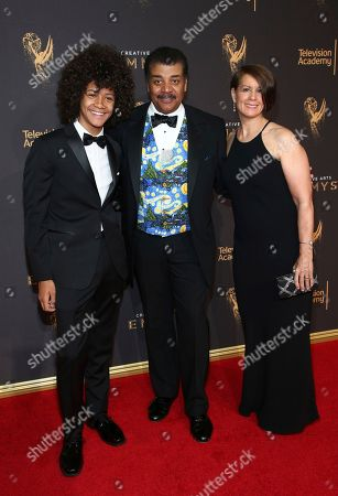 Neil deGrasse Tyson, Alice Young, Travis Tyson. Travis Tyson, from left, Neil deGrasse Tyson, and Alice Young arrive at night one of the Television Academy's 2017 Creative Arts Emmy Awards at the Microsoft Theater, in Los Angeles