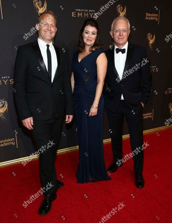 Tom Hugh-Jones, Elizabeth White, Mike Gunton. Tom Hugh-Jones, from left, Elizabeth White, and Mike Gunton arrive at night one of the Television Academy's 2017 Creative Arts Emmy Awards at the Microsoft Theater, in Los Angeles