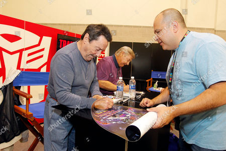 Peter Cullen, Frank Welker. Peter Cullen, left, and Frank Welker, center, the voices behind two of the most iconic adversaries ?TRANSFORMERS characters OPTIMUS PRIME and MEGATRON, sign autographs for Anthony De Capua, right, at HASCON ? the first-ever FANmily? event from Hasbro, Inc.,, in Providence, R.I