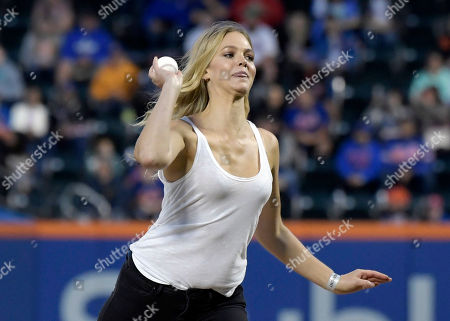 Model Erin Heatherton throws out the first pitch before a baseball game between the Cincinnati Reds and the New York Mets, in New York