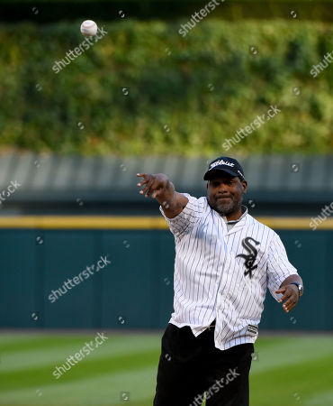 Hall of Famer and former Chicago White Sox player Tim Raines throws out a ceremonial first pitch before the baseball game between the White Sox and the San Francisco Giants in Chicago on