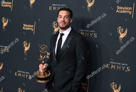 """Ezra Edelman poses in the press room with the award for outstanding directing for a nonfiction program for """"O.J.: Made in America"""" during night one of the Creative Arts Emmy Awards at the Microsoft Theater, in Los Angeles"""