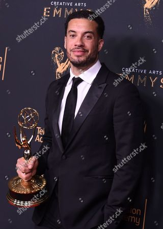 """Ezra Edelman poses in the press room with his award for outstanding directing for a nonfiction program for """"O.J.: Made in America"""" during night one of the Creative Arts Emmy Awards at the Microsoft Theater, in Los Angeles"""