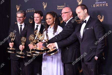 "Angus Wall, Spencer Averick, Ava Duvernay, Howard Barish, Jason Sterman. Angus Wall, from left, Spencer Averick, Ava Duvernay, Howard Barish, and Jason Sterman pose in the press room with the award for outstanding documentary or non-fiction special for ""13th"" during night one of the Creative Arts Emmy Awards at the Microsoft Theater, in Los Angeles"