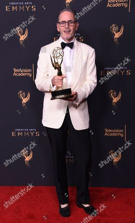 Keith Ian Raywood poses in the press room with the award for outstanding production design for a variety, nonfiction, reality or reality-competition series during night one of the Creative Arts Emmy Awards at the Microsoft Theater, in Los Angeles