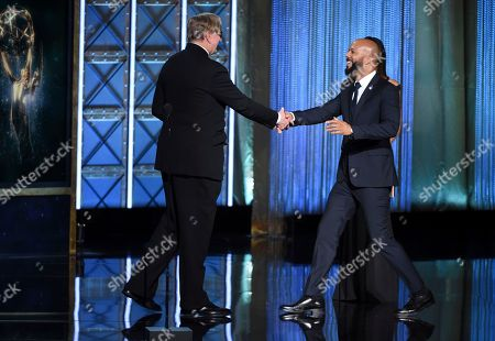"""T Bone Burnett, Common. T Bone Burnett, left, presents the award for outstanding original music and lyrics for """"13th Song Title: Letter to the Free"""" to Common during night one of the Television Academy's 2017 Creative Arts Emmy Awards at the Microsoft Theater, in Los Angeles"""