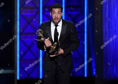 """Ezra Edelman accepts the award for outstanding directing for a nonfiction program for """"O.J.: Made in America"""" during night one of the Television Academy's 2017 Creative Arts Emmy Awards at the Microsoft Theater, in Los Angeles"""