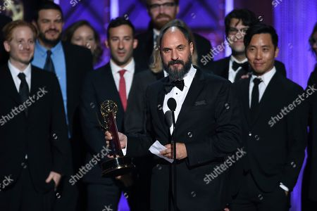 """Loren Bouchard and the team from """"Bob's Burgers"""" accept the award for outstanding animated program during night one of the Television Academy's 2017 Creative Arts Emmy Awards at the Microsoft Theater, in Los Angeles"""