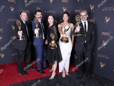 Dan Meehan, Ekin Akalin, Lynn Cho, Leanne Dare, Angus Wall. Dan Meehan, from left, Ekin Akalin, Lynn Cho, Leanne Dare, and Angus Wall pose for a portrait with the award for outstanding motion design for '13th' during night one of the Television Academy's 2017 Creative Arts Emmy Awards at the Microsoft Theater, in Los Angeles