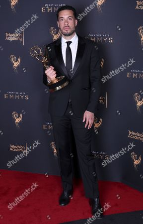 """Ezra Edelman poses for a portrait with his award for outstanding directing for a nonfiction program for """"O.J.: Made in America"""" during night one of the Television Academy's 2017 Creative Arts Emmy Awards at the Microsoft Theater, in Los Angeles"""