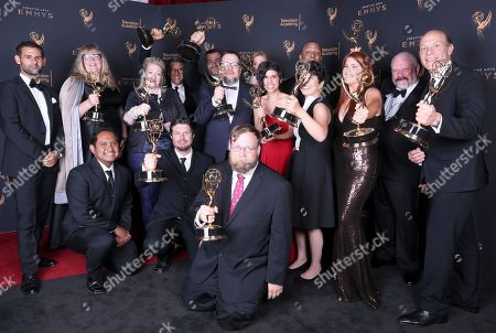 Stock Image of Cole Sanchez, Oliverr Akuin, Lindsey Pollard, Jennifer Pelphrey, Rob Sorcher, Curtis Leash, Kent Osborne, Jack Pendarvis, Maureen Mlynarczyk, Conrad Montgomery, Ashly Burch, Pendleton Ward, Elizabeth Ito, Kelly Crews, Michel Lyman, Brian A. Miller. Cole Sanchez, from left, Oliverr Akuin, Lindsey Pollard, Jennifer Pelphrey, Rob Sorcher, Curtis Leash, Kent Osborne, Jack Pendarvis, Maureen Mlynarczyk, Conrad Montgomery, Ashly Burch, Pendleton Ward, Elizabeth Ito, Kelly Crews, Michel Lyman, and Brian A. Miller pose for a portrait with the award for outstanding short form animated program for 'Adventure Time' during night one of the Television Academy's 2017 Creative Arts Emmy Awards at the Microsoft Theater, in Los Angeles
