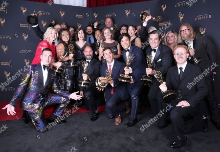 Stock Image of Loren Bouchard, Jim Dauterive, Dan Fybel, Rich Rinaldi, Greg Thompson, Jon Schroeder, Nora Smith, Scott Jacobson, Steven Davis, Kelvin Yu, Lizzie Molyneux, Wendy Molyneux, Holly Schlesinger, Janelle Momary-Neely, Joel Kuwahara, Scott Greenberg, Bernard Derriman, Chris Song. Loren Bouchard, from left, Jim Dauterive, Dan Fybel, Rich Rinaldi, Greg Thompson, Jon Schroeder, Nora Smith, Scott Jacobson, Steven Davis, Kelvin Yu, Lizzie Molyneux, Wendy Molyneux, Holly Schlesinger, Janelle Momary-Neely, Joel Kuwahara, Scott Greenberg, Bernard Derriman, and Chris Song pose for a portrait with the award for outstanding animated program for 'Bob's Burgers' during night one of the Television Academy's 2017 Creative Arts Emmy Awards at the Microsoft Theater, in Los Angeles