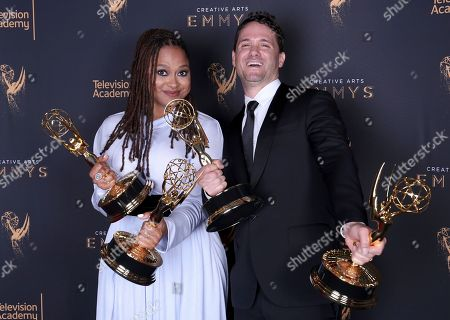 """Ava DuVernay, Spencer Averick. Ava DuVernay, left, and Spencer Averick pose for a portrait with the awards for outstanding documentary or nonfiction special, and for outstanding writing for nonfiction program for """"13th"""" during night one of the Television Academy's 2017 Creative Arts Emmy Awards at the Microsoft Theater, in Los Angeles"""