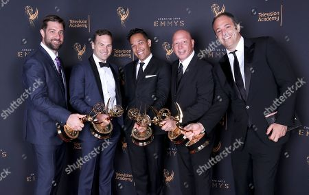 Matt Renner, Dan Lindsay, TJ Martin, Jonathan Chinn, Simon Chinn. Matt Renner, from left, Dan Lindsay, TJ Martin, Jonathan Chinn, and Simon Chinn pose for a portrait with the award for exceptional merit in documentary filmmaking for 'LA 92' during night one of the Television Academy's 2017 Creative Arts Emmy Awards at the Microsoft Theater, in Los Angeles