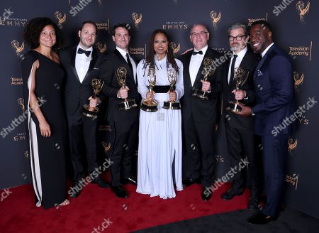 "Kira Kelly, Jason Sterman, Spencer Averick, Ava DuVernay, Howard Parish, Angus Wall, Hans Charles. Kira Kelly, from left, Jason Sterman, Spencer Averick, Ava DuVernay, Howard Parish, Angus Wall, and Hans Charles pose for a portrait with the awards for outstanding documentary or nonfiction special, and for outstanding writing for nonfiction program for ""13th""during night one of the Television Academy's 2017 Creative Arts Emmy Awards at the Microsoft Theater, in Los Angeles"