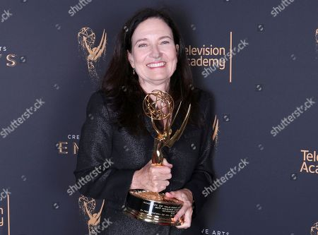 Stock Picture of Sally Jo Fifer poses for a portrait with the governors award during night one of the Television Academy's 2017 Creative Arts Emmy Awards at the Microsoft Theater, in Los Angeles