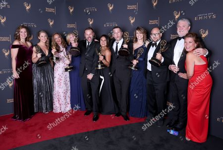 Amy Savitsky, Jeana Dill, Leah Remini, Devon Graham Hammonds, Alex Weresow, Rachelle Mendez, Erin Gamble, Aaron Sandmann, Eli Holzman, Mike Rinder, Elaine Frontain Bryant. Amy Savitsky, from left, Jeana Dill, Leah Remini, Devon Graham Hammonds, Alex Weresow, Rachelle Mendez, Erin Gamble, Aaron Sandmann, Eli Holzman, Mike Rinder, and Elaine Frontain Bryant pose for a portrait with the award for outstanding informational series or special for 'Leah Remini: Scientology and the Aftermath' during night one of the Television Academy's 2017 Creative Arts Emmy Awards at the Microsoft Theater, in Los Angeles